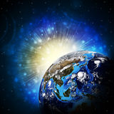Earth planet in sun rays Royalty Free Stock Photo