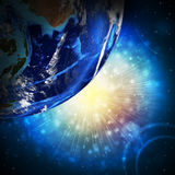 Earth planet in sun rays Royalty Free Stock Image