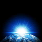 Earth planet in sun rays Stock Photography