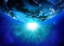 Earth planet in sun rays Stock Images