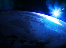 Earth planet in sun rays Royalty Free Stock Photos