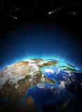 Earth planet in sun rays Stock Photo