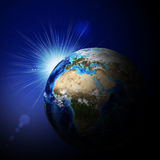Earth planet in sun rays Royalty Free Stock Images
