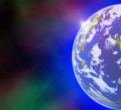 Earth planet on sun and stars background with flare Stock Photography