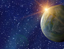 Earth planet on sun and stars background with flare Stock Photos