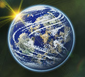 Earth planet on sun and stars background with flare Royalty Free Stock Photos