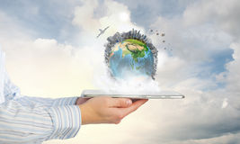 Earth planet on tablet pc Royalty Free Stock Images