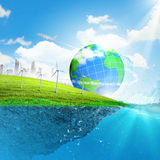Earth planet in water Royalty Free Stock Photos