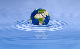 Earth planet on blue water ripple. Globe Earth over natural water scene. Global world background. Environmental graphic element Stock Image