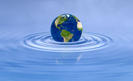 Earth planet on blue water ripple. Globe Earth over natural water scene. Global world background. Environmental graphic element Stock Photography