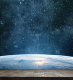 Earth planet with wooden floo Royalty Free Stock Photo