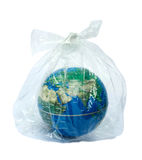 The earth & plastic bag. The earth in plastic bag Stock Photo