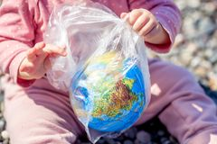 The Earth in a plastic bag. World Environment Day concept. stock photo