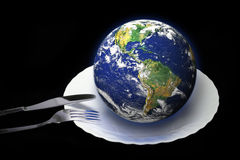Earth on a plate Royalty Free Stock Photo
