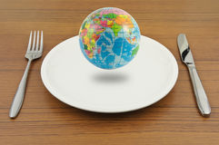 Earth on plate, Ready for eat. Floating earth on plate with knife and fork, Ready for eat Stock Image