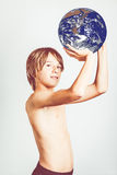 Earth player. Child with earth in hand stock photography