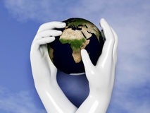 Earth is protected by our hands Royalty Free Stock Photo