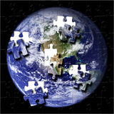 Earth Puzzle (NASA Photo). Puzzle of the Earth with pieces falling out stock illustration