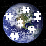 Earth Puzzle (NASA Photo). Puzzle of the Earth with pieces missing royalty free illustration