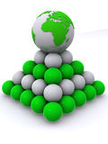 Earth on pyramid from spheres Stock Images