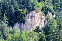 Earth pyramids in the landscape of the mountains in south tyrol italy stock photography
