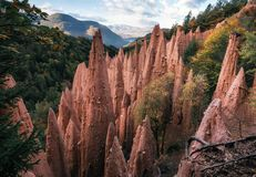 Earth pyramids in South Tyrol, Italy. Earth pyramids with stones on top in Renon Ritten region, South Tyrol, Italy royalty free stock image