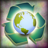 Earth Recycle. Earth atop of green Recycle Symbol Stock Photos