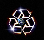 Earth Recycle. Giant glowing recycle symbol floating in outerspace, save planet earth, Elements of image provided by NASA Royalty Free Stock Photo