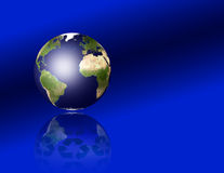 Earth with recycle symbols. Reflecting Stock Images