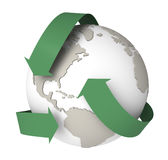 Earth Recycling. The earth surrounded by Recycling symbol Royalty Free Stock Photos