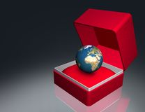 Earth in red gift box Stock Photos