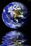 Earth reflected in water Stock Images