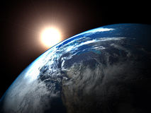 Earth and the rising Sun. High quality render of the Earth, the rising Sun and it's rays