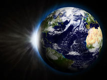 Earth with Rising Sun Royalty Free Stock Photos