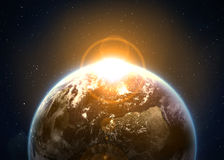 Earth with the rising sun Royalty Free Stock Photography