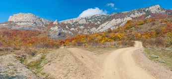 Earth road in autumnal mountains. Mountain pasture Demerdzhi, Crimean peninsula stock image