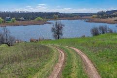 Earth road leading down to Suha Sura river in Vasylivka village near Dnepr city stock photos
