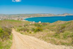Earth road leading from Kara-dag natural reserve to settlement Kotebel on a Black Sea shore Stock Photo