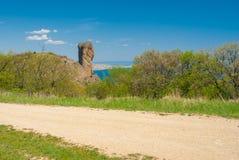 Earth road near Devil Finger crag in Karadag National park, Crimean peninsula Stock Photos