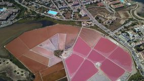 Earth`s line. A drone vertical perspective of the ground`s colors and shapes. Salt flats at Ses Salines, Mallorca, Spain. Earth`s line. A drone vertical stock video footage