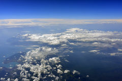 Earth's surface with sea and clouds Stock Photography