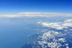 Earth's surface with sea and clouds Stock Image