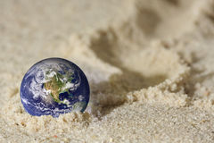 Earth in sand Royalty Free Stock Images