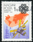Earth Satellite and Map. HUNGARY - CIRCA 1983: stamp printed by Hungary, shows Earth Satellite and Map, circa 1983 Stock Photo