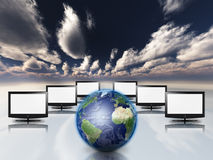 Earth and screens Royalty Free Stock Photos