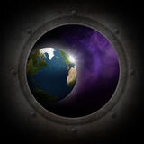 Earth seen from the space. Earth globe seen from the spaceship porthole Royalty Free Stock Photography