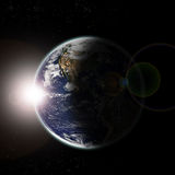 Earth seen from space at sun dawn and stars Stock Image