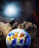 The Earth set on collision orbit with asteroids. Our home planet Earth in danger of being attacked in space by asteroids. Original images credited to NASA royalty free illustration