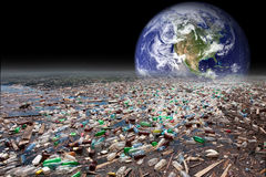 Earth sinking in pollution. Image showing earth sinking in heavy water pollution with tons of plastic containers Stock Images