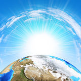 Earth on sky background Royalty Free Stock Image